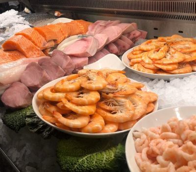 selection of meat and fish at restaurant counter